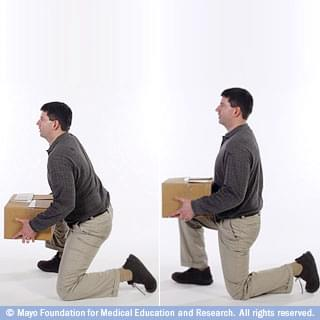 Man Bringing Box to Knee